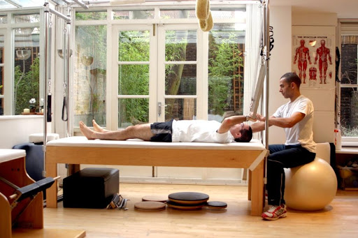 Tony Kosoko at work in our in house Pilates Studio
